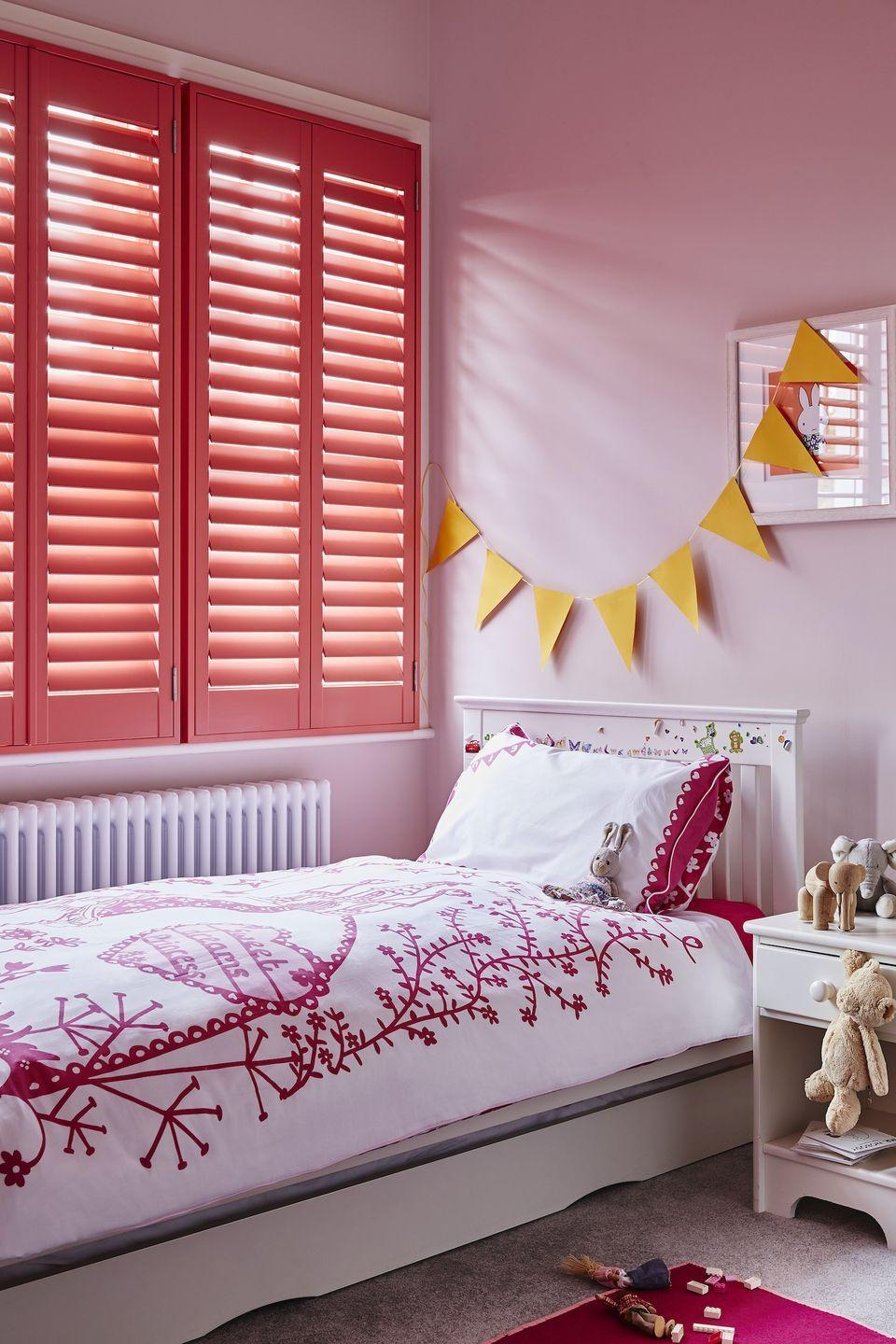 """<p>Shutters are a great way to add a burst of colour to an otherwise neutral scheme, or to add a punchier look to an existing group of colours. They're great for privacy and you can adjust the amount of light that comes through. It also works well during the warmer months to add shade and keep the bedroom cool. For a girl's bedroom, use colours in similar tones as shown here to keep the room vibrant.</p><p>Pictured: Full height shutters, <a href=""""https://www.shutterlyfabulous.com/shutters/full-height-shutters/"""" rel=""""nofollow noopener"""" target=""""_blank"""" data-ylk=""""slk:Shutterly Fabulous"""" class=""""link rapid-noclick-resp"""">Shutterly Fabulous</a></p>"""
