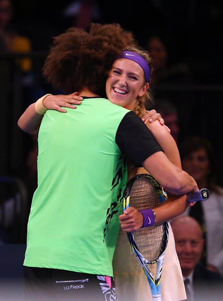 NEW YORK, NY - MARCH 04:  LMFAO singer Redfoo hugs Victoria Azarenka of Belarus during her match against Serena Williams of the USA the BNP Paribas Showdown on March 4, 2013 at Madison Square Garden in New York City.  (Photo by Elsa/Getty Images)