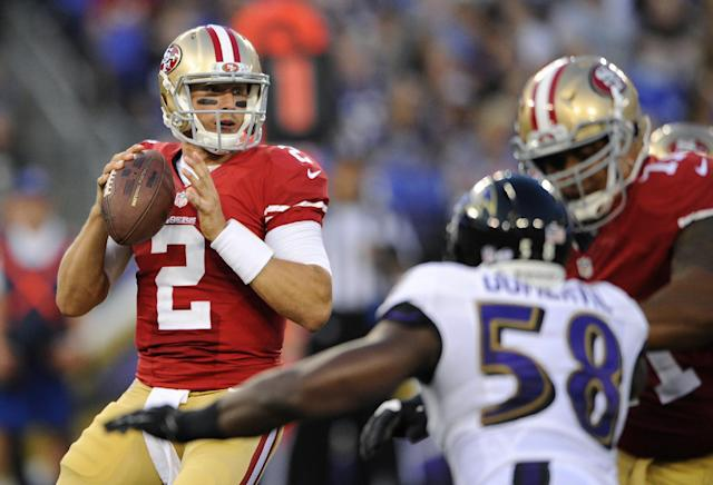 San Francisco 49ers quarterback Blaine Gabbert (2) looks for a receiver as he is pressured by Baltimore Ravens outside linebacker Elvis Dumervil (58) in the first half of an NFL preseason football game, Thursday, Aug. 7, 2014, in Baltimore. (AP Photo/Nick Wass)
