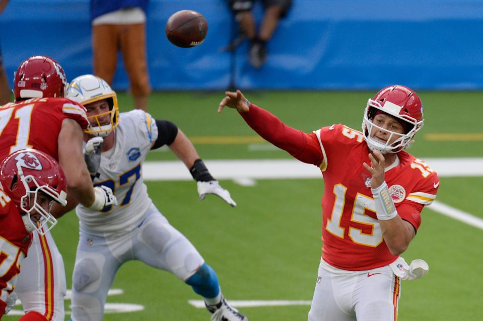 Kansas City Chiefs quarterback Patrick Mahomes (15) throws against the Los Angeles Chargers during overtime of an NFL football game Sunday, Sept. 20, 2020, in Inglewood, Calif.