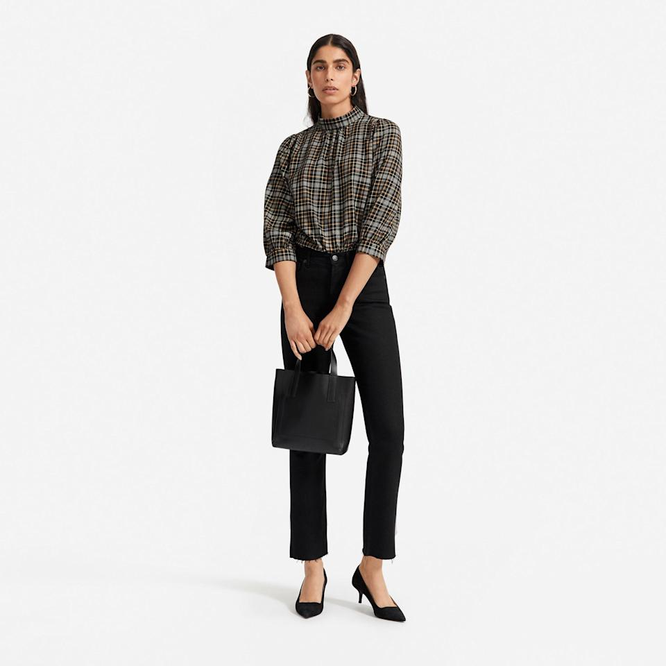 """<p><strong>Everlane</strong></p><p>everlane.com</p><p><strong>$58.00</strong></p><p><a href=""""https://go.redirectingat.com?id=74968X1596630&url=https%3A%2F%2Fwww.everlane.com%2Fproducts%2Fwomens-mockneck-flannel-shirt-blackkhakiplaid&sref=https%3A%2F%2Fwww.cosmopolitan.com%2Fstyle-beauty%2Ffashion%2Fg32678355%2Fflannel-outfits-how-to-wear%2F"""" rel=""""nofollow noopener"""" target=""""_blank"""" data-ylk=""""slk:Shop Now"""" class=""""link rapid-noclick-resp"""">Shop Now</a></p><p>No buttons here! A flannel in this silhouette looks super chic and profesh, even more so when paired with kitten heels and a sleek top handle bag. </p>"""