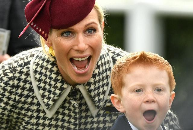 Zara Tindall poses alongside Archie McCoy, the son of jockey AP McCoy, during the RSA Insurance Novices' Chase on Ladies Day at Cheltenham Festival. It was day to remember for six-year-old Archie as he watched the horse named after his father – Champ – ridden to victory by jockey Barry Geraghty