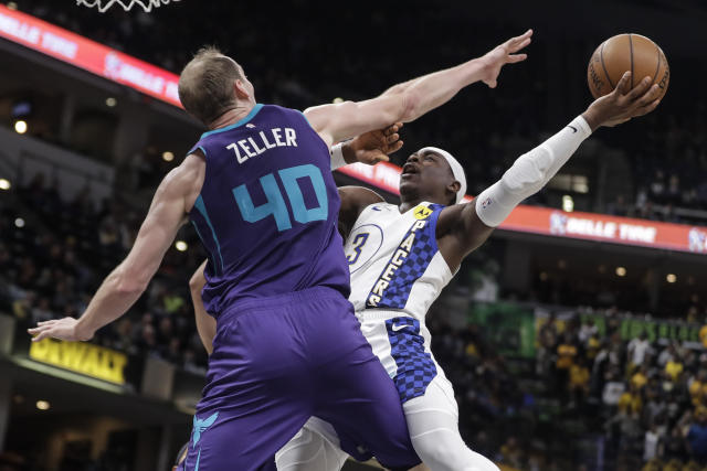 Indiana Pacers' Aaron Holiday (3) shoots against sCharlotte Hornets' Cody Zeller (40) during the second half of an NBA basketball game, Sunday, Dec. 15, 2019, in Indianapolis. (AP Photo/Darron Cummings)