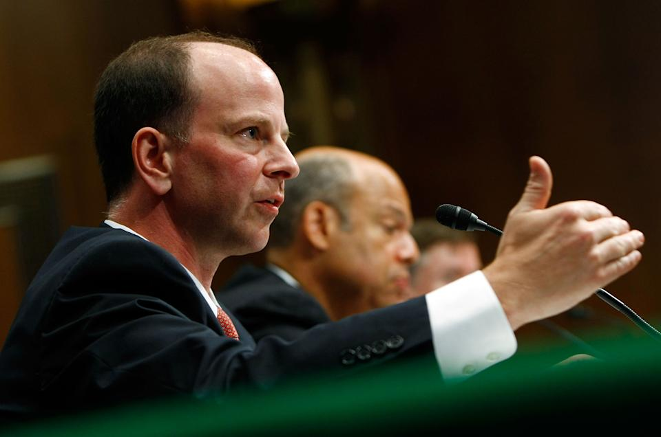 Assistant Attorney General David Kris, left, of the Justice Department's National Security Division testifies with Jeh Johnson, the Defense Department's general counsel, before the Senate Armed Services Committee in July 2009.