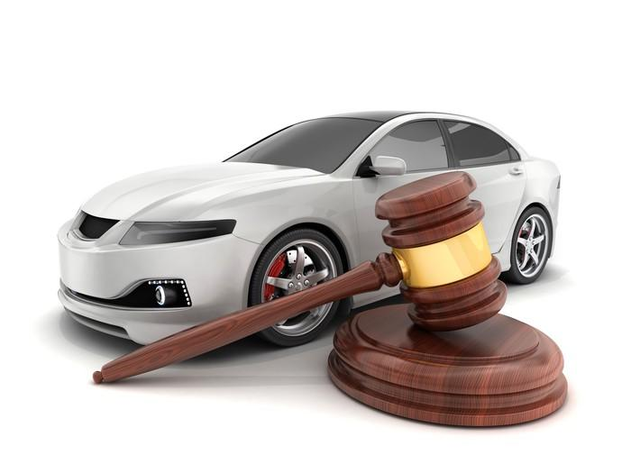 White car next to an auctioneer's gavel.