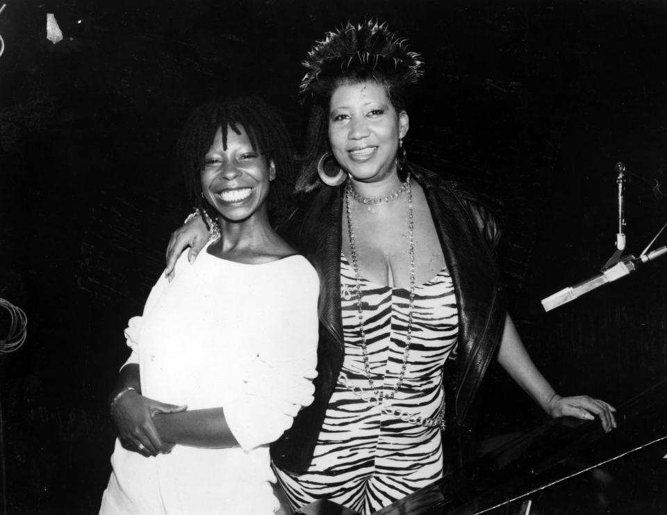 <p>Aretha Franklin wears a leaopard print mini dress, leather shawl jacket, and gold hoop earrings while posing with comedian and actress Whoopi Goldberg. (Photo by Afro American Newspapers/Gado/Getty Images) </p>