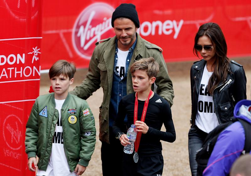 David and Victoria Beckham (pictured) at the London marathon sponsored by Virgin Money: Getty Images