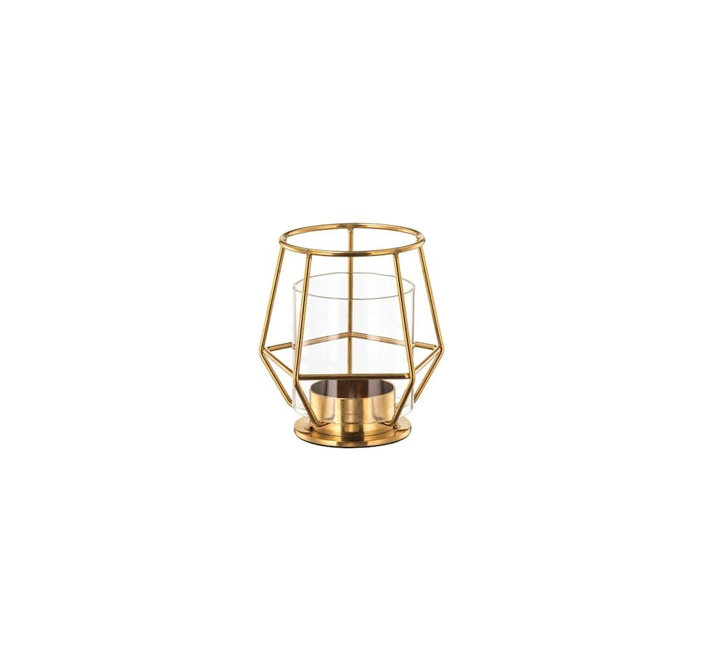"<p>At just $6 (plus the cost of a tealight), this gilt, structural item can perch prettily on a bookshelf, side table, or etagere—and cast some soothing light at the same time.</p> <p><strong>To buy: </strong>$6; <a href=""https://www.ikea.com/us/en/catalog/products/50348545/"">ikea.com.</a></p>"