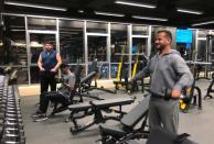 Men exercise at a gym in Amman