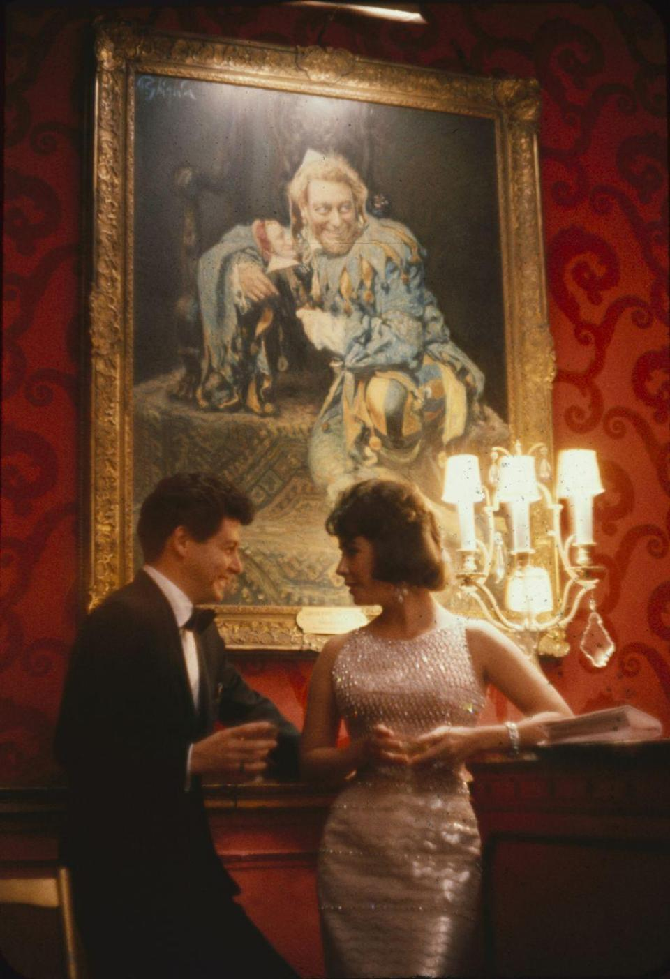 <p>After Mike's death, Elizabeth leaned on friend Eddie Fisher. It was then that the two began a scandalous affair. Eddie was married to actress Debbie Reynolds at the time, and their romance resulted in Elizabeth being labeled as a homewrecker.</p>