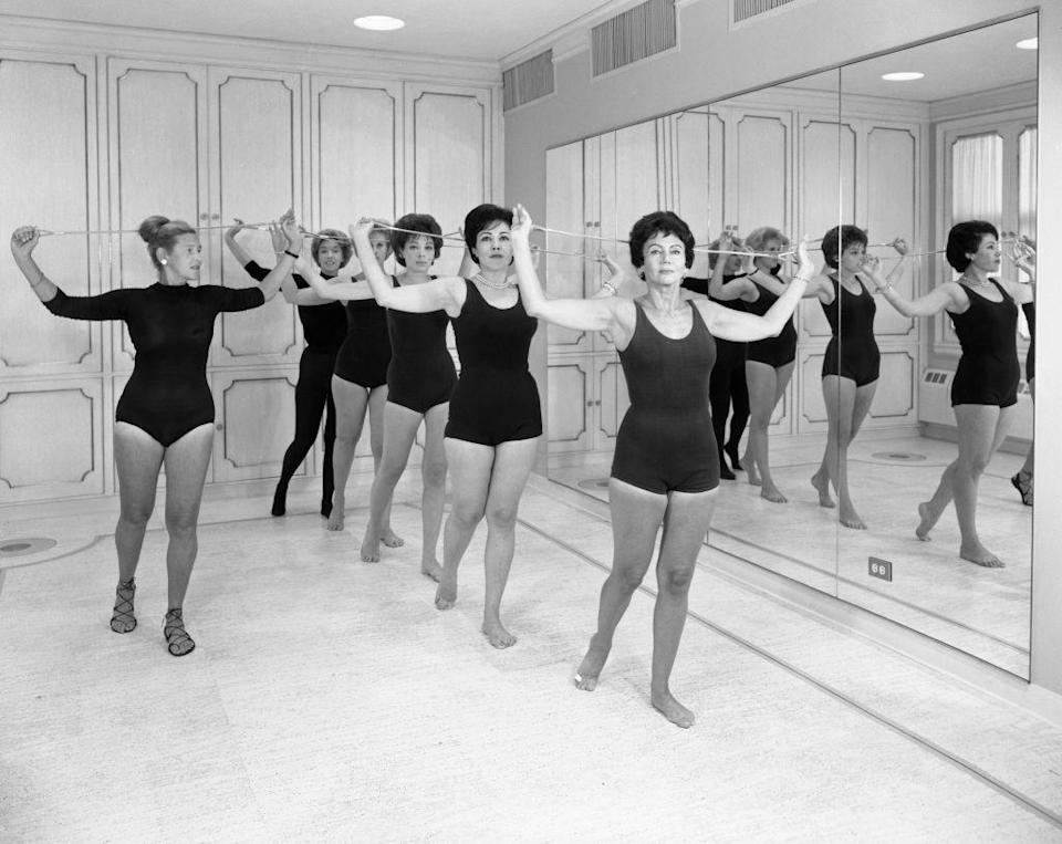 "<p>In this photo, women work out in the gym at Helena Rubinstein Beauty Salon in new York City. The salon was a <a href=""https://mashable.com/2015/03/08/helena-rubinstein-glamor-factory/"" rel=""nofollow noopener"" target=""_blank"" data-ylk=""slk:popular"" class=""link rapid-noclick-resp"">popular</a> gym and beauty spa for women at the time.<br></p>"