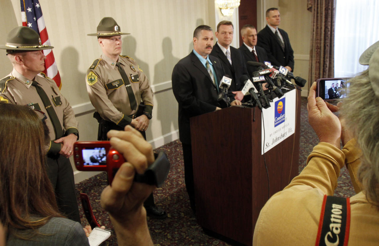 Vermont State Police Major Ed Ledo, center, speaks during a news conference Wednesday, March 28, 2012 in St. Johnsbury, Vt. Allen and Patricia Prue are being charged in connection with the killing of Vermont prep school teacher Melissa Jenkins, who police say was strangled. Thirty-year-old Allen Prue of Waterford and his 33-year-old wife Patricia Prue are facing 2nd degree murder charges in connection with the killing of Jenkins. (AP Photo/Toby Talbot)