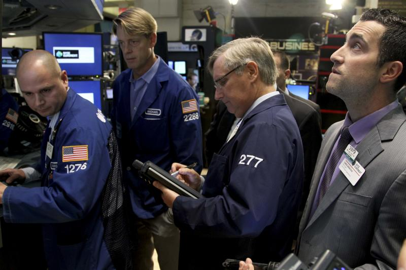 Traders work on the floor at the New York Stock Exchange in New York, Wednesday, Oct. 31, 2012. Traffic is snarled, subways out of commission, streets flooded and power out in many parts of the city, but the New York Stock Exchange opened without hitch Wednesday after an historic two-day shutdown, courtesy of Hurricane Sandy. (AP Photo/Seth Wenig)