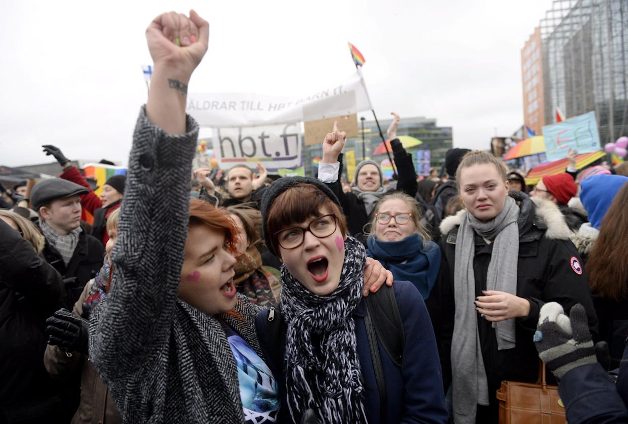 Supporters of the same-sex marriage celebrate outside the Finnish Parliament in Helsinki, Finland on November 28, 2014 after the Finnish parliament approved a bill allowing same sex marriage. AFP PHOTO /Lehtikuva/ VESA MOILANEN *** FINLAND OUT *** (Photo credit should read VESA MOILANEN/AFP/Getty Images)