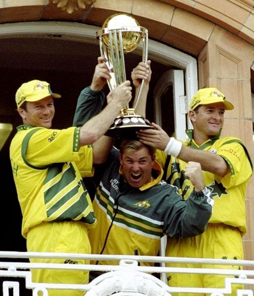 Steve Waugh, Shane Warne and Mark Waugh of Australia lift the trophy after victory over Pakistan in the Cricket World Cup Final at Lord's in London. Australia won by 8 wickets.Graham Chadwick /Allsport