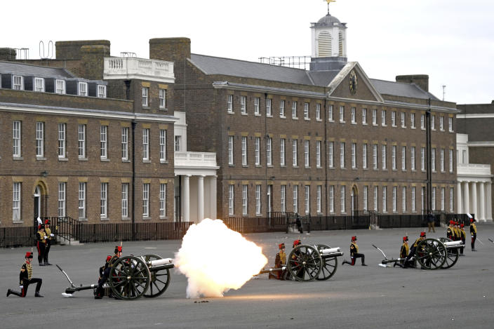 Members of the King's Troop Royal Horse Artillery fire a 41-round gun salute at Woolwich Barracks, to mark the death of Prince Philip, in London, Saturday, April 10, 2021. Britain's Prince Philip, the irascible and tough-minded husband of Queen Elizabeth II who spent more than seven decades supporting his wife in a role that mostly defined his life, died on Friday. (Daniel Leal-Olivas/Pool Photo via AP)