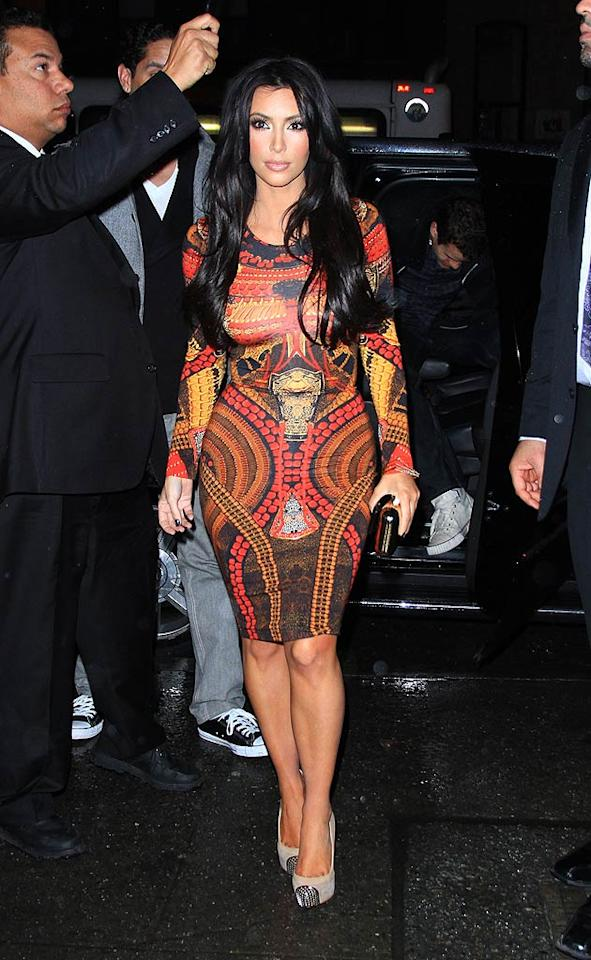"""Prince may have kicked her off his stage the other night for her lack of smooth moves, but reality star Kim Kardashian's concert-going gear was undeniably divine. Are you a fan of her Alexander McQueen samurai-print dress and Christian Louboutin """"Maggie"""" pumps? Jackson Lee/<a href=""""http://www.splashnewsonline.com"""" target=""""new"""">Splash News</a> - February 7, 2011"""