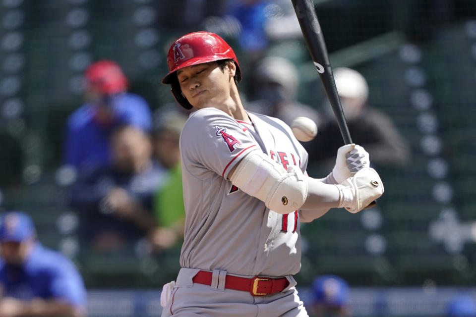 Los Angeles Angels Shohei Ohtani ducks a high and inside pitch during the fifth inning of a baseball game against the Seattle Mariners, Sunday, May 2, 2021, in Seattle. (AP Photo/Ted S. Warren)