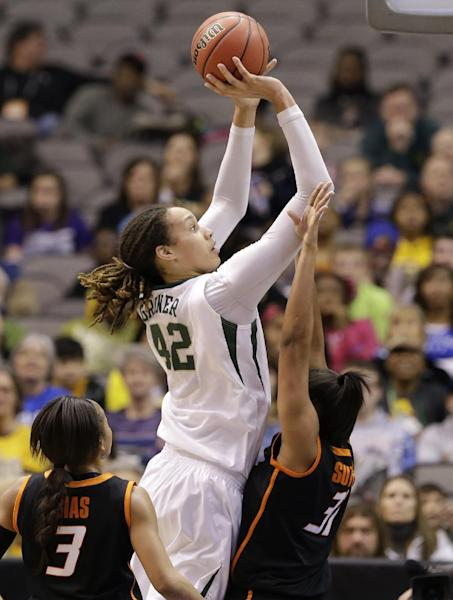 Baylor center Brittney Griner (42) goes up for a shot over Oklahoma State's Tiffany Bias (3) and Kendra Suttles (31) in the second half of an NCAA college basketball game in the Big 12 women's tournament Sunday, March 10, 2013, in Dallas. Griner had a game-high 30-points in the 77-69 Baylor win. (AP Photo/Tony Gutierrez)