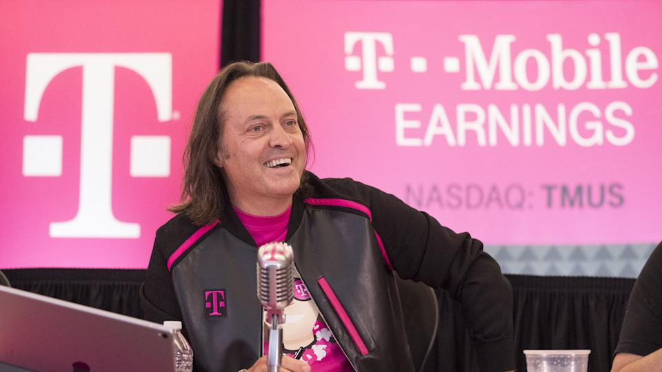 Mandatory Credit: Photo by AP/REX/Shutterstock (8966486a)T-Mobile President and CEO John Legere answers questions during the T-Mobile Q2 earnings call, in Bellevue, Wash.