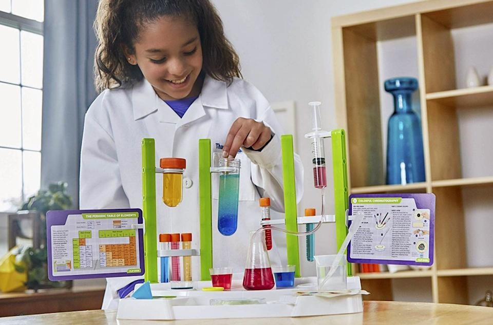 Thames & Kosmos Ooze Labs Chemistry Station Science Experiment Kit with girl playing