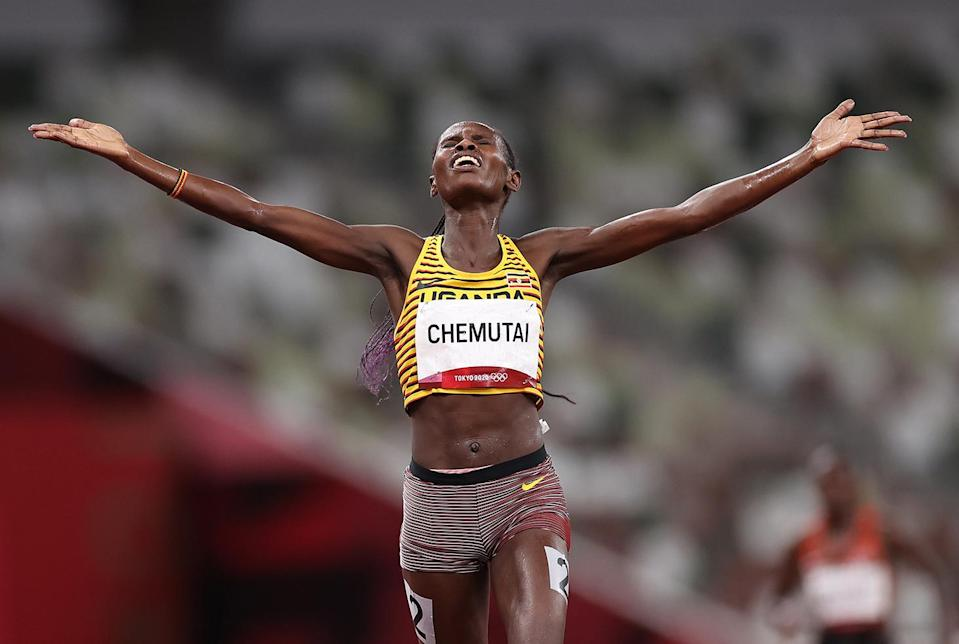 <p>Team Uganda's Peruth Chemutai soaks in her gold medal in the Women's 3000m Steeplechase Final at Olympic Stadium on August 4.</p>