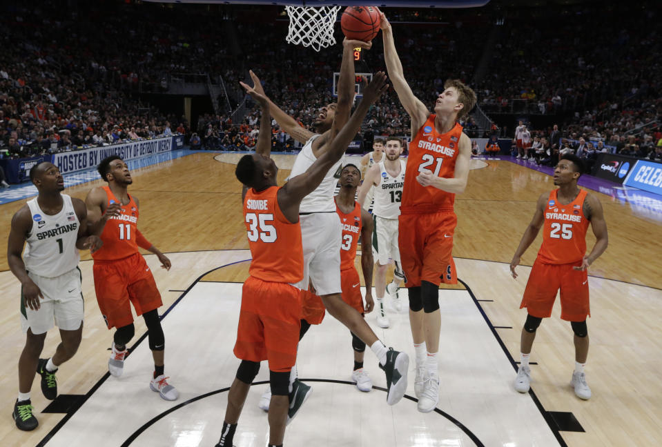 Syracuse forward Marek Dolezaj (21), of Slovakia, blocks a shot by Michigan State forward Nick Ward (44) during the second half of an NCAA men's college basketball tournament second-round game in Detroit, Sunday, March 18, 2018. Syracuse won 55-53. (AP Photo/Paul Sancya)
