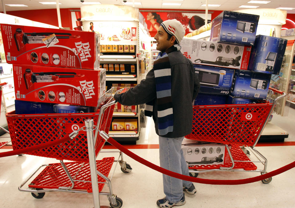 A man waits in line to check out at a Target store on Black Friday in Lanesborough, Massachusetts November 26, 2010. (REUTERS/Adam Hunger)