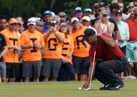 Mar 11, 2018; Palm Harbor, FL, USA; Tiger Woods lines up his putt on the 13th during the final round of the Valspar Championship golf tournament at Innisbrook Resort - Copperhead Course. Jasen Vinlove-USA TODAY Sports