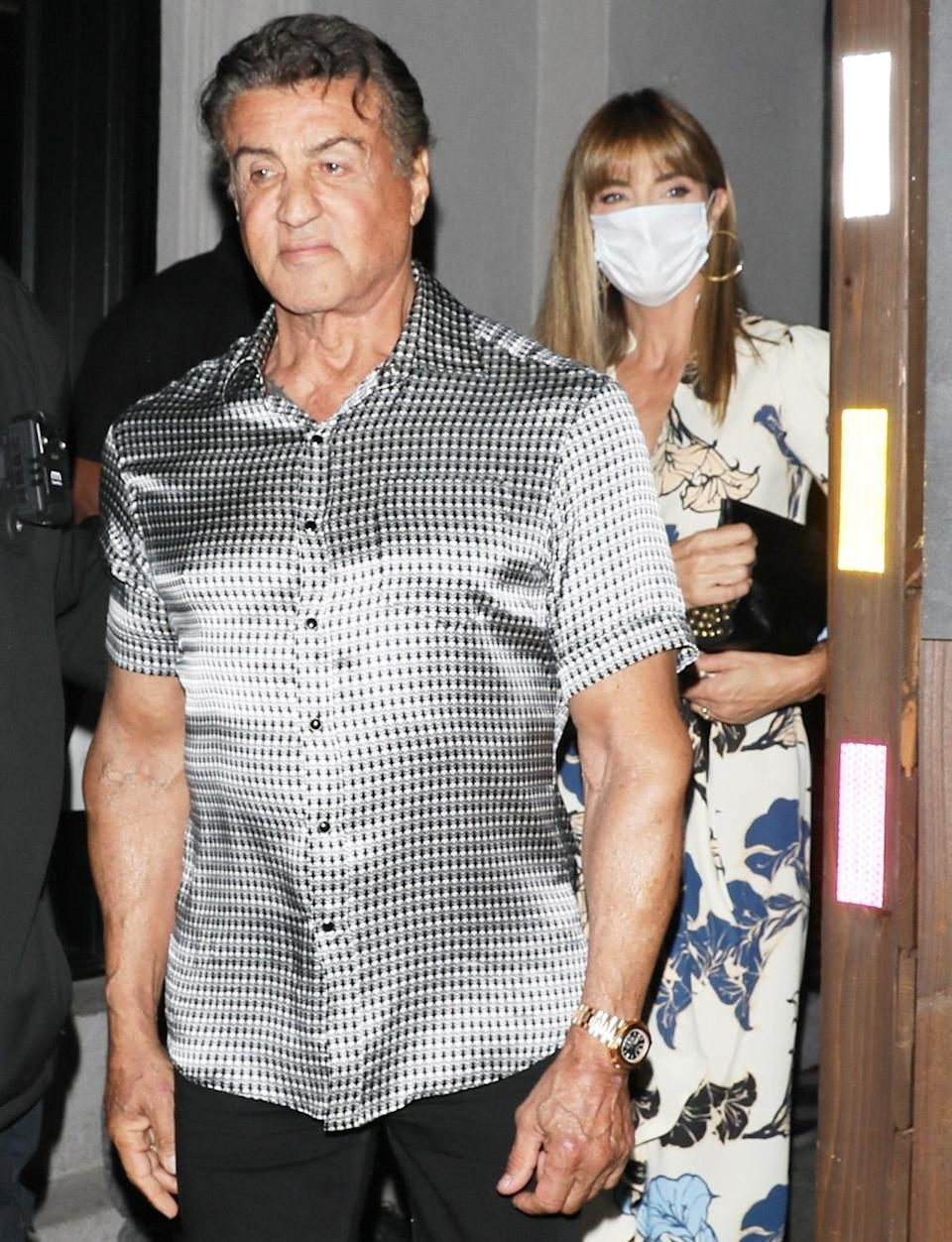 <p>Sylvester Stallone and wife Jennifer Flavin leave Craig's restaurant after dinner in West Hollywood on June 1.</p>