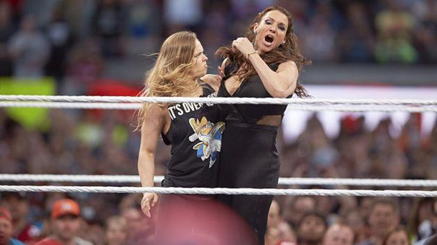 Ronda Rousey puts a arm hold on WWE's Stephanie McMahon at Wrestlemania this year.