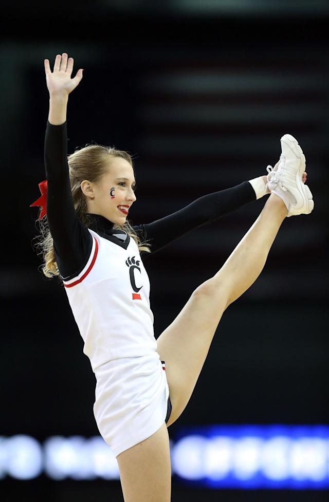 SPOKANE, WA - MARCH 20: A Cincinnati Bearcats cheerleader in action during their game against the Harvard Crimson in the second round of the 2014 NCAA Men's Basketball Tournament at Spokane Veterans Memorial Arena on March 20, 2014 in Spokane, Washington. (Photo by Stephen Dunn/Getty Images)