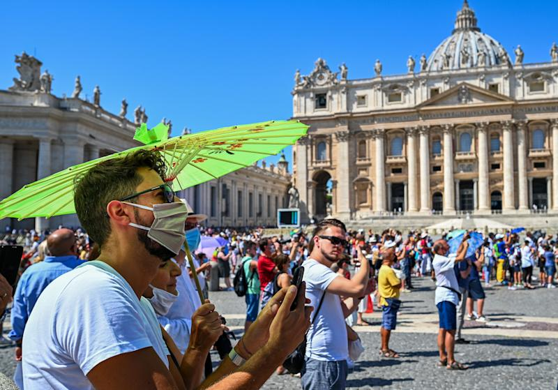 Worshipers, some wearing a face mask, attend the Pope's weekly Angelus prayer at St. Peter's Square in The Vatican on August 23, 2020 during the pandemic. Source: AFP/Getty Images