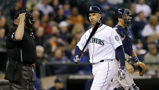 Umpire Wally Bell, left, calls out Seattle Mariners' Raul Ibanez on strikes in the second inning of a baseball game as Houston Astros catcher Jason Castro walks toward the mound Wednesday, April 10, 2013, in Seattle. (AP Photo/Elaine Thompson)