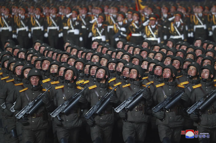 """In this photo provided by the North Korean government, North Korean soldiers march in formation during a military parade marking the ruling party congress, at Kim Il Sung Square in Pyongyang, North Korea Thursday, Jan. 14, 2021. North Korea rolled out developmental ballistic missiles designed to be launched from submarines and other military hardware in a parade that punctuated leader Kim Jong Un's defiant calls to expand his nuclear weapons program. Independent journalists were not given access to cover the event depicted in this image distributed by the North Korean government. The content of this image is as provided and cannot be independently verified. Korean language watermark on image as provided by source reads: """"KCNA"""" which is the abbreviation for Korean Central News Agency. (Korean Central News Agency/Korea News Service via AP)"""