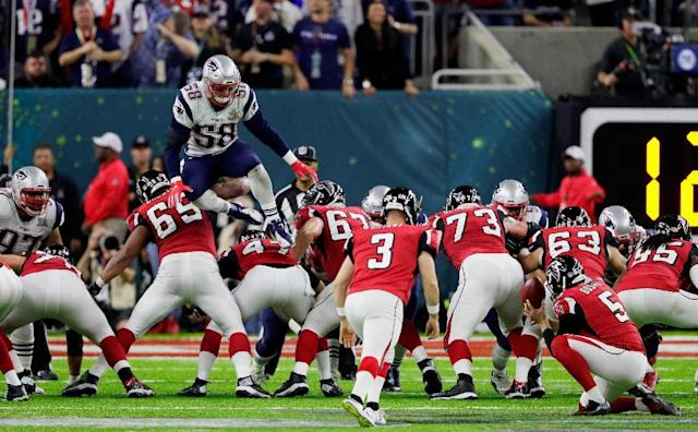 Shea McClellin of the New England Patriots attempts to block a field goal attempt by leaping over the Atlanta Falcons linemen during Super Bowl 51 at NRG Stadium on February 5, 2017 (AFP Photo/JAMIE SQUIRE)