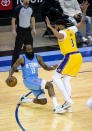 Houston Rockets guard James Harden (13) falls as he tries to drive on Los Angeles Lakers forward Anthony Davis (3) during the first quarter of an NBA basketball game Tuesday, Jan. 12, 2021, in Houston. (Mark Mulligan/Houston Chronicle via AP)