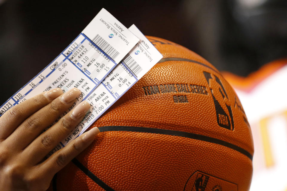 Phoenix Suns' tickets and an NBA basketball against Miami Heat during the first half of an NBA basketball game Thursday, Nov. 7, 2019, in Phoenix. (AP Photo/Darryl Webb)