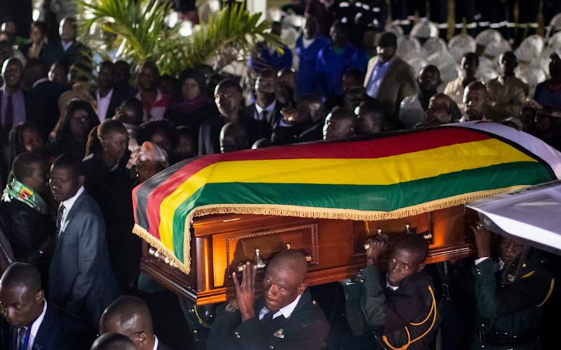 The body of former president Robert Mugabe arrives to lie in state inside his official residence in the capital Harare, Zimbabwe Wednesday, Sept. 11, 2019.  - AP