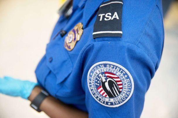 PHOTO: A Transportation Security Administration officer stands in the pre-check area at Dulles International Airport in Dulles, Va., Aug. 19, 2015. (Andrew Harrer/Bloomberg via Getty Images, FILE)