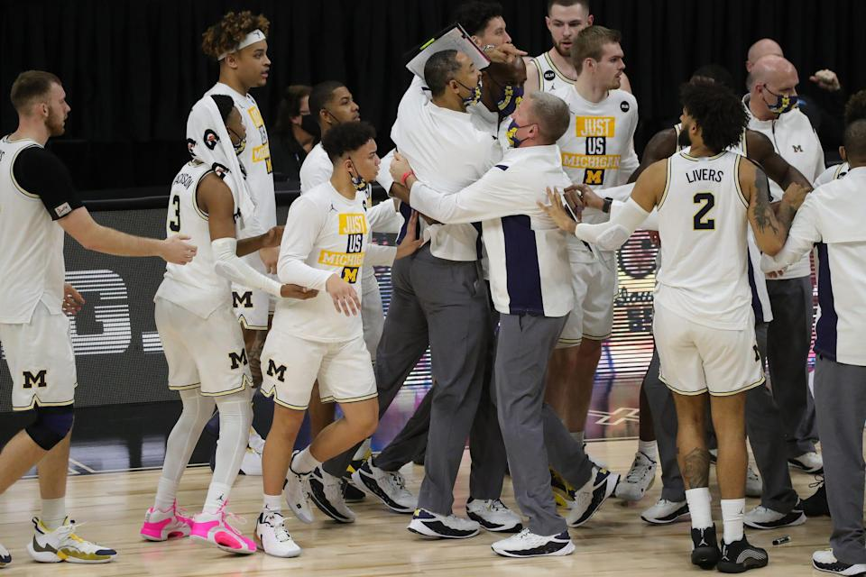 Michigan Wolverines head coach Juwan Howard is held back by his team and ejected against the Maryland Terrapins in the Big Ten tournament quarterfinals Friday, March 12, 2021 at Lucas Oil Stadium in Indianapolis.
