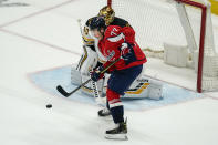 Washington Capitals right wing T.J. Oshie (77) watches a shot as Boston Bruins goaltender Tuukka Rask (40) makes a save during the second period of Game 2 of an NHL hockey Stanley Cup first-round playoff series Monday, May 17, 2021, in Washington. (AP Photo/Alex Brandon)