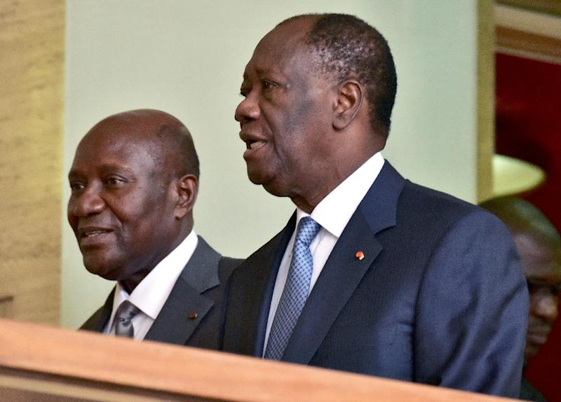 Outgoing Ivorian Prime Minister Daniel Kablan Duncan (L) walks with Ivorian president Alassane Ouattara (R), following his resignation at the presidential palace in Abidjan, following his resignation on January 9, 2017