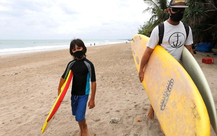Surfers returned to the beaches, but in masks - AP