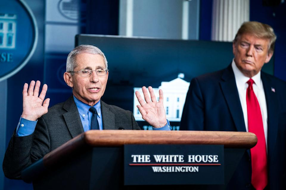 Dr Anthony Fauci speaks as Donald Trump watches on. Source: Getty