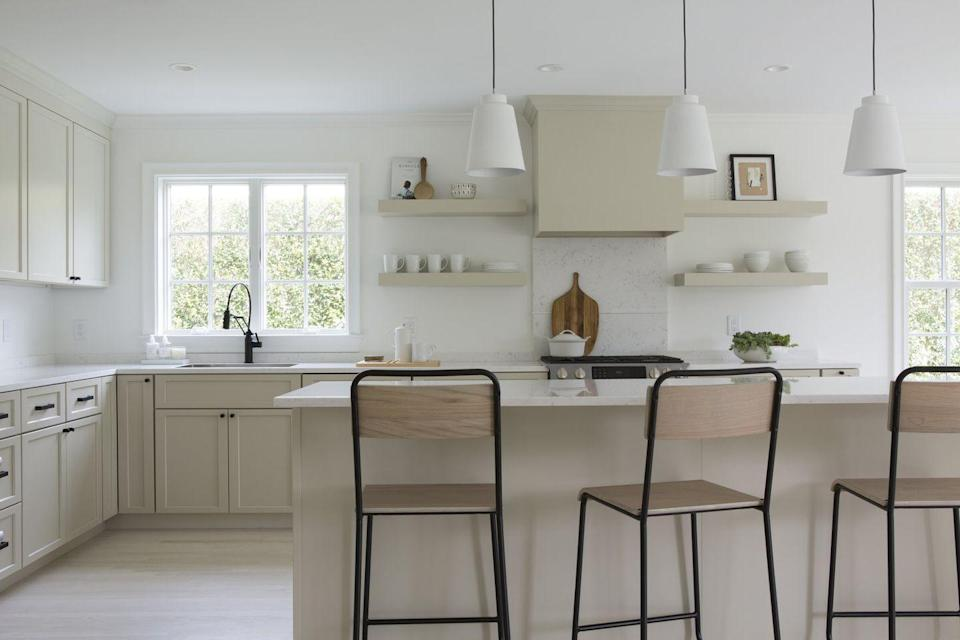 """<p>Don't limit your kitchen style to one design style, says Gabriela Gargano of <a href=""""https://www.grisorodesigns.com/"""" rel=""""nofollow noopener"""" target=""""_blank"""" data-ylk=""""slk:Grisoro Designs"""" class=""""link rapid-noclick-resp"""">Grisoro Designs</a>. """"I think we'll see more traditional cabinetry and vintage lighting being mixed in with contemporary elements like clean slab counters and backsplashes,"""" she explains. """"The end result is a beautifully unique space that's both modern and traditional at once.""""</p>"""