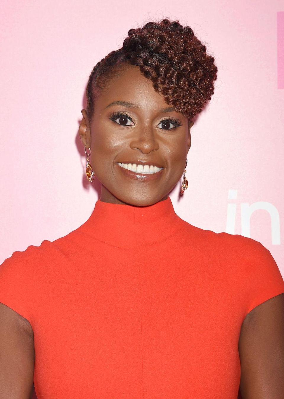"""<p>An unexptected twist on fringe, <strong>Issa Rae</strong> rocks a braided updo with <a href=""""https://www.goodhousekeeping.com/beauty/hair/g33267765/types-of-bangs/"""" rel=""""nofollow noopener"""" target=""""_blank"""" data-ylk=""""slk:a textured bang"""" class=""""link rapid-noclick-resp"""">a textured bang</a>. This protective style is easy to maintain when you sleep. Re-twist the front of the bangs to maintain definition and tie your hair down to keep the sides sleek. </p>"""