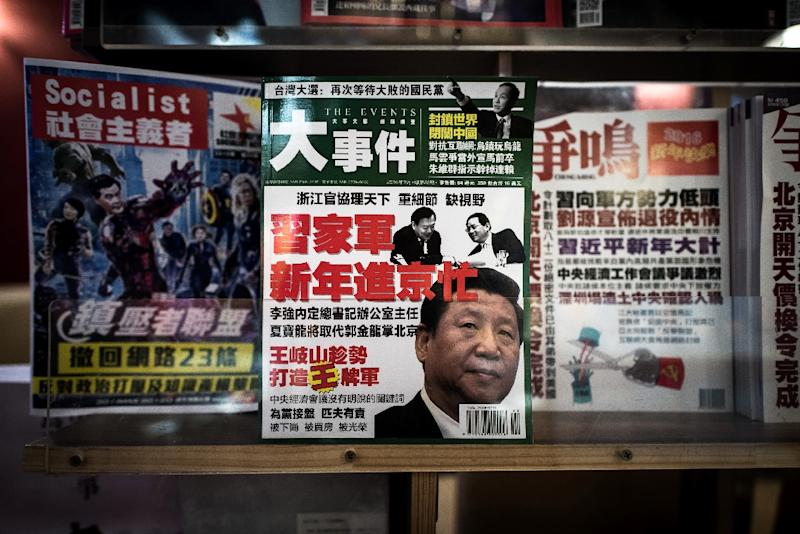Magazines about Chinese politics displayed in a bookstore in Hong Kong's Causeway Bay district on January 5, 2016 (AFP Photo/Philippe Lopez)
