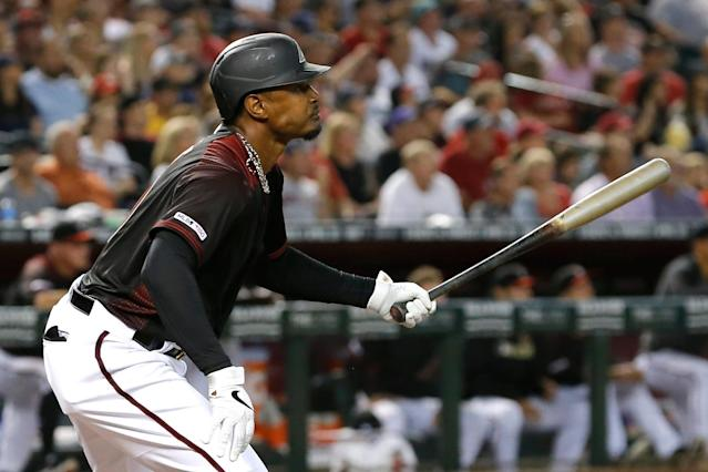 Arizona Diamondbacks' Adam Jones watches his RBI-single in the second inning during a baseball game against the Boston Red Sox, Saturday, April 6, 2019, in Phoenix. (AP Photo/Rick Scuteri)