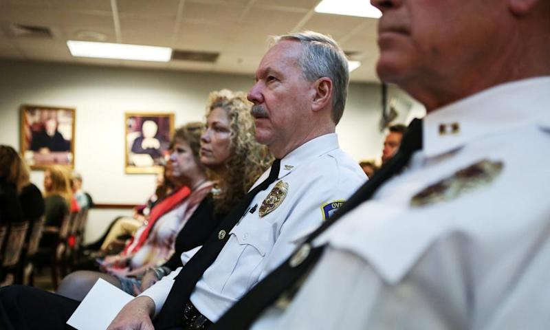 St Louis County police listen to the attorney general, Jeff Sessions, speak about efforts to combat violent crime. Sessions has begun to pull back federal scrutiny of local police departments.